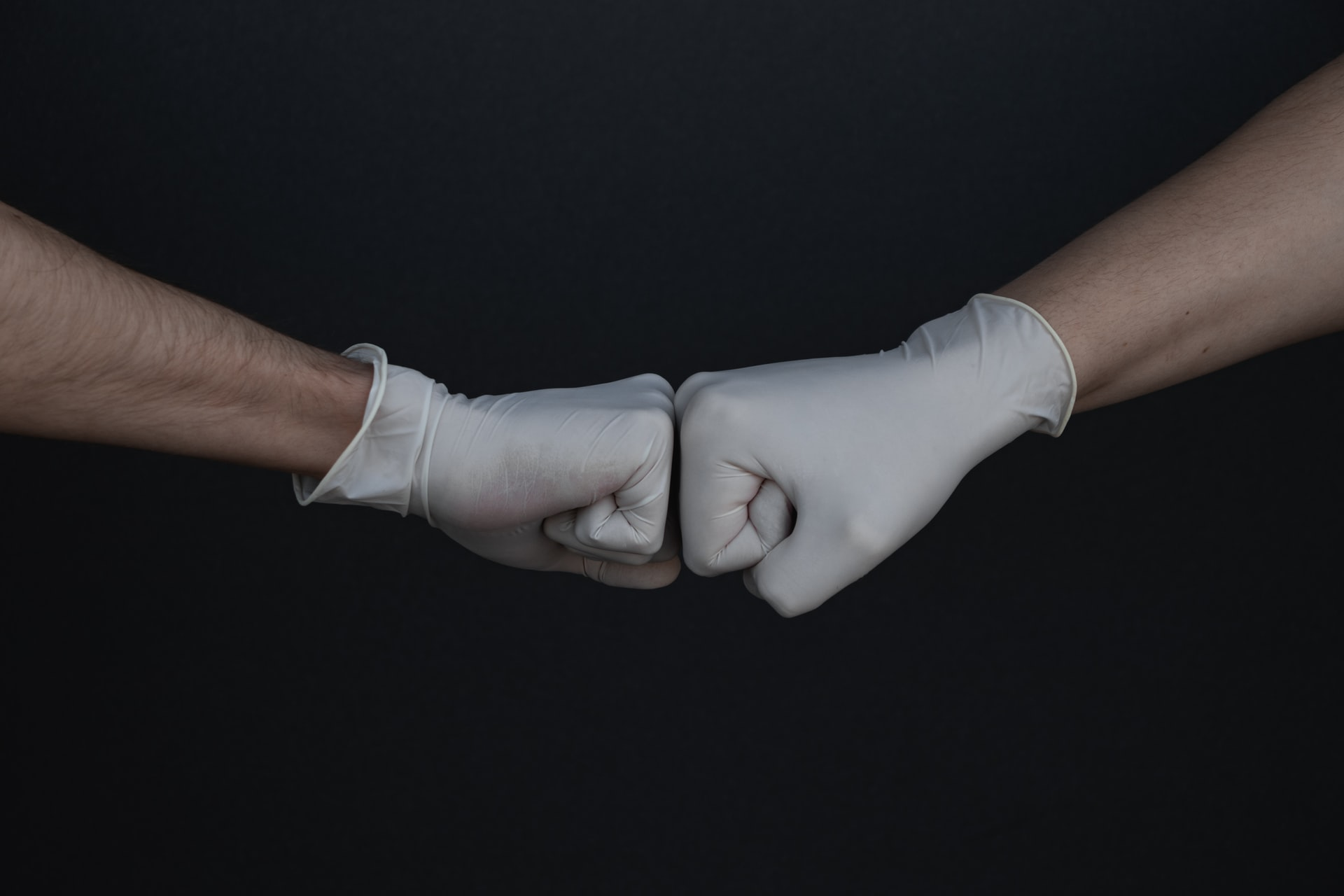 fist bump with protective gloves